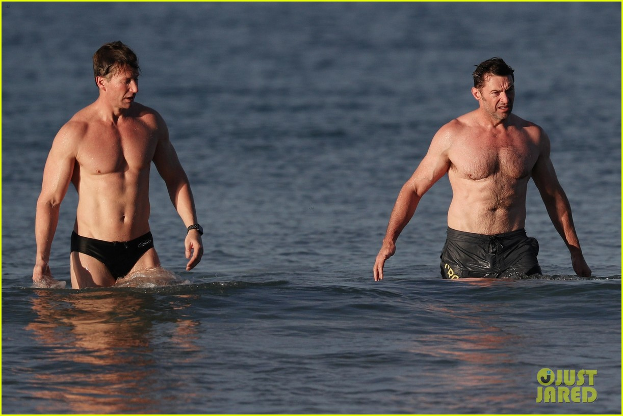 hugh jackman runs shirtless on the beach with his ripped muscles 033935919