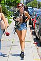 bella thorne leaves little to the imagination in plunging 32