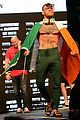 conor mcgregor and floyd mayweather face off at the weigh ins ahead of fight 07