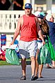 liev schreiber shows off his arm muscles in red tank top 01