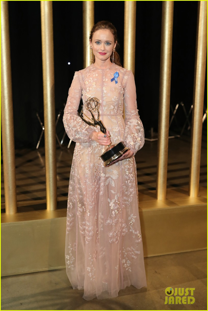 alexis bledel celebrates her handmaids tale win at the creative arts emmys 023954634