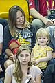 prince harry makes funny faces for a baby at the invictus games 18
