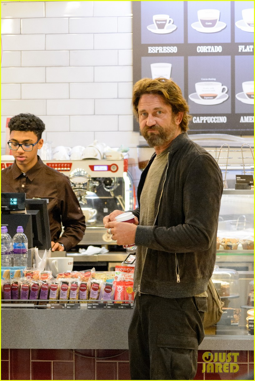 gerard butler arrives in london following motorcycle accident 023974692