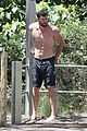 chris hemsworth goes shirtless at beach in australia 03