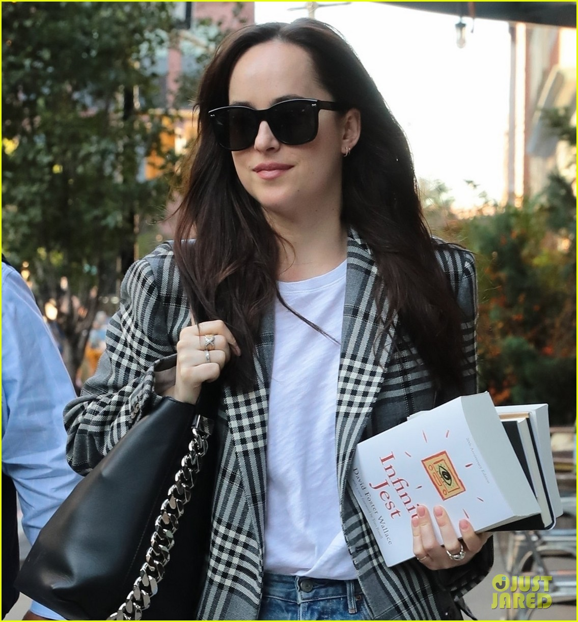 dakota johnson sports long plaid coat while out in nyc 033974708