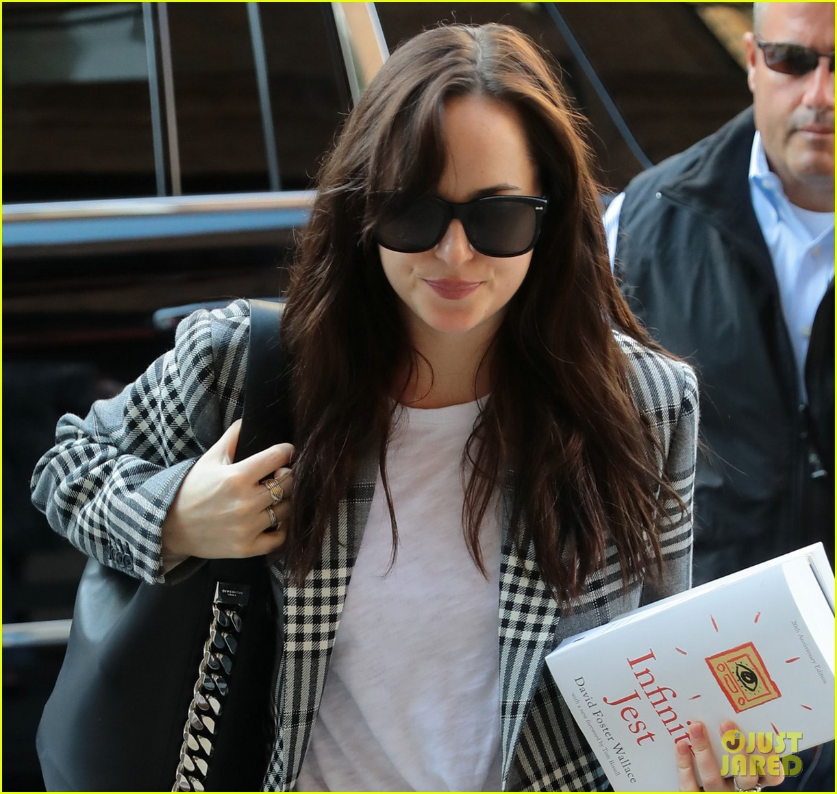 dakota johnson sports long plaid coat while out in nyc 053974710