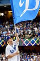 mila kunis ashton kutcher wave dodgers flag 04