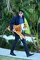 garrett hedlund carries giant stuffed tiger around the neighborhood 23