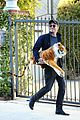 garrett hedlund carries giant stuffed tiger around the neighborhood 30