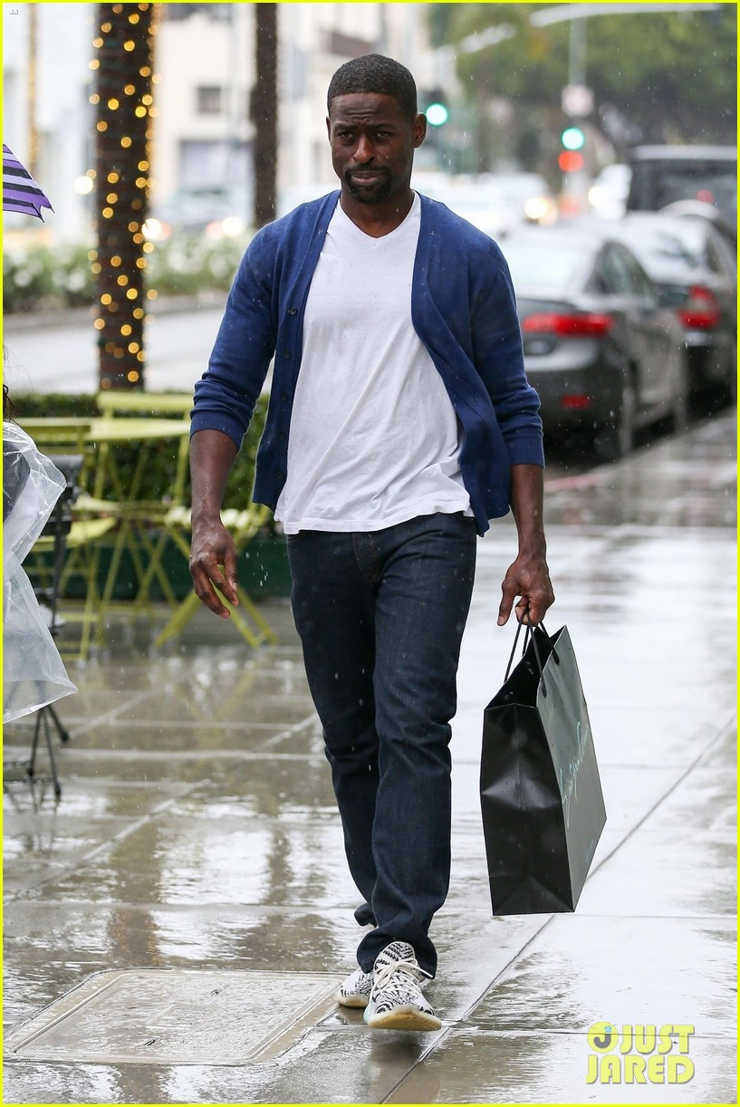 sterling k brown braves the rain in beverly hills 014012101
