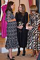 pregnant kate middleton attends fashion event at buckingham palace 23