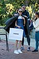 emmy rossum rocks denim dress with white t shirt for shopping trip 06