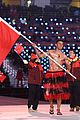 tonga flag bearer returns to winter olympics 04