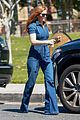 isla fisher rocks a denim jumpsuit while shopping in beverly hills 02