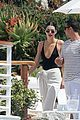 kendall jenner rocks black thong swimsuit while poolside in cannes 13
