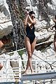kendall jenner rocks black thong swimsuit while poolside in cannes 19