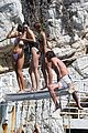kendall jenner rocks black thong swimsuit while poolside in cannes 21