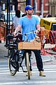 liev schreiber takes his pup for a bike ride in nyc 03