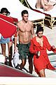dua lipa boyfriend isaac carew lounge by the pool in miami 03