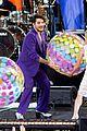 adam lambert pairs purple suit with silver heels for gmas summer concert series 07