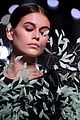 kaia gerber dons feathered frock for givenchy fashion show 04