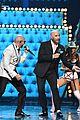 john travolta teams up with pitbull for live performance at univisions premio lo nuestro 2020 01