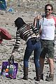 gerard butler relaxes at the beach with morgan brown 03