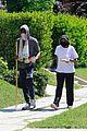 chadwick boseman walks with a walking stick 19