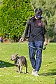 henry golding back at dog park with his foster dog 04