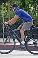 shia labeouf buys a child trailer for his bicycle 11
