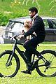 usher carries his dog bike ride girlfriend jennifer giocoechea 03