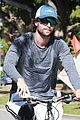 patrick schwarzenegger throws up peace on a bike ride 04