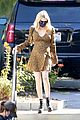 emma roberts dress baby bump gold black dress 03