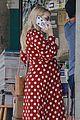 emma roberts shows off bump mag stand run 23