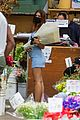 emily ratajkowski cradles her growing baby bump shopping for flowers 11