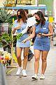 emily ratajkowski cradles her growing baby bump shopping for flowers 23