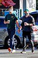 jesse tyler ferguson justin mikita hold hands coffee run 05