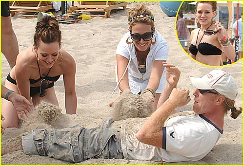 Hilary Duff Buries Paparazzi in the Sand