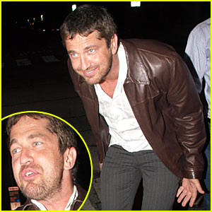 Gerard Butler Plays It Up For Paparazzi