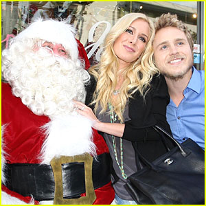 Spencer & Heidi Get Santa Smooches