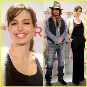 Angelina Jolie & Johnny Depp Make It To Madrid