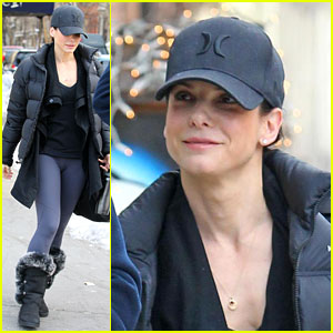 Sandra Bullock braves the cold weather in some workout gear to go to