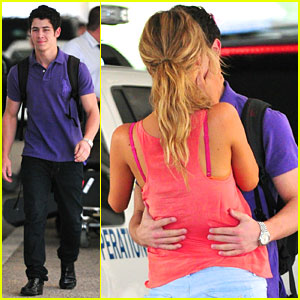 Nick Jonas & Delta Goodrem Kiss at LAX!