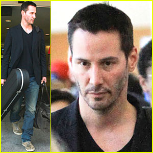 Keanu Reeves Lands at LAX