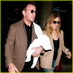 Guy Ritchie Carries His Son Through LAX