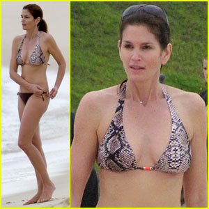 The 45-year-old model took a dip in the ocean and a stroll with her ...