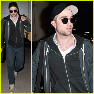 Robert Pattinson Gets Escorted Out of LAX