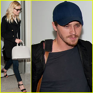 5f6835e306d8f Kirsten Dunst leads the way through LAX Airport as her beau Garrett Hedlund  follows close behind on Sunday (May 6) in Los Angeles.