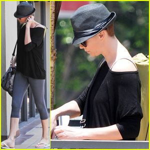 Charlize Theron Flaunts a Fedora