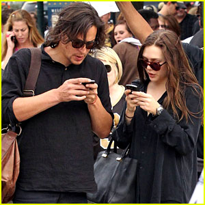 Elizabeth Olsen: New Orleans Saints Game with Male Pal